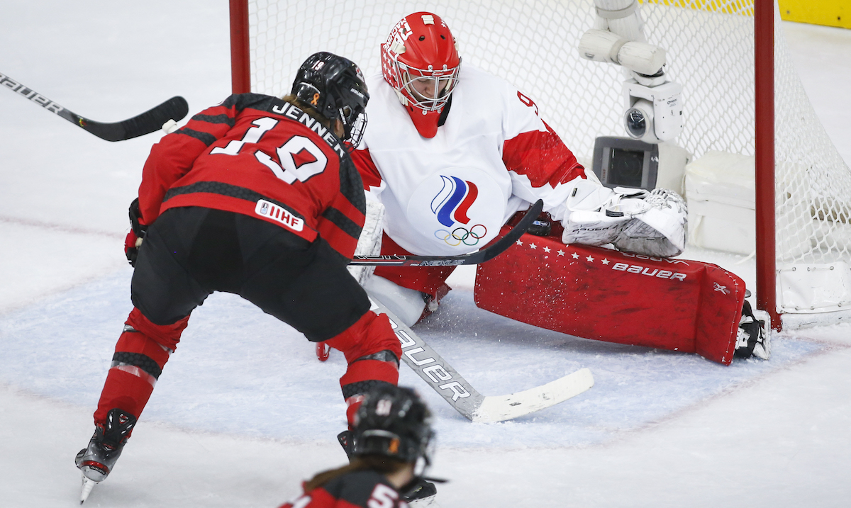Russia's goalie Nadezhda Morozova, right, stops a shot from Canada's Brianne Jenner during first period IIHF Women's World Championship hockey action in Calgary, Alta., Sunday, Aug. 22, 2021. THE CANADIAN PRESS/Jeff McIntosh
