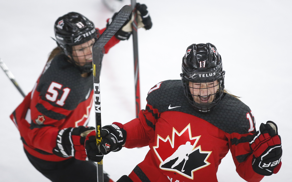 Canada's Ella Shelton, right, celebrates her goal with teammate Canada's Victoria Bach during second period IIHF Women's World Championship hockey action against Russia in Calgary, Alta., Sunday, Aug. 22, 2021. THE CANADIAN PRESS/Jeff McIntosh