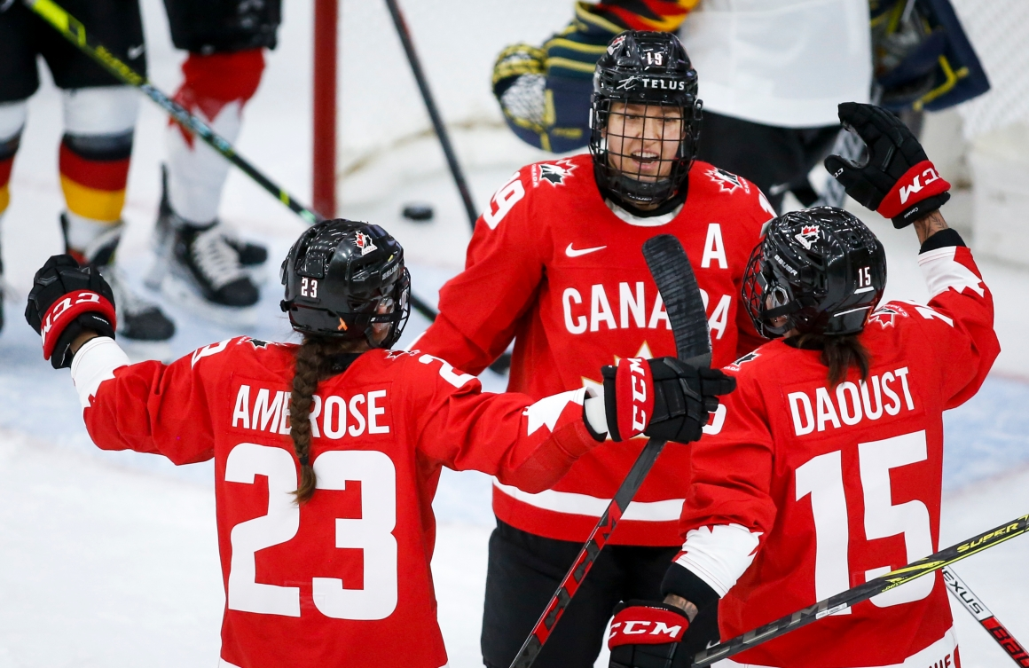 Brianne Jenner celebrates with teammates