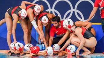 Team Canada huddles against Australia