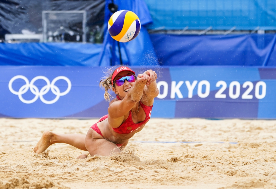 Canadian beach volleyball players Heather Bansley plays the ball