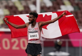 Canadian distance runner Mohammed Ahmed celebrates