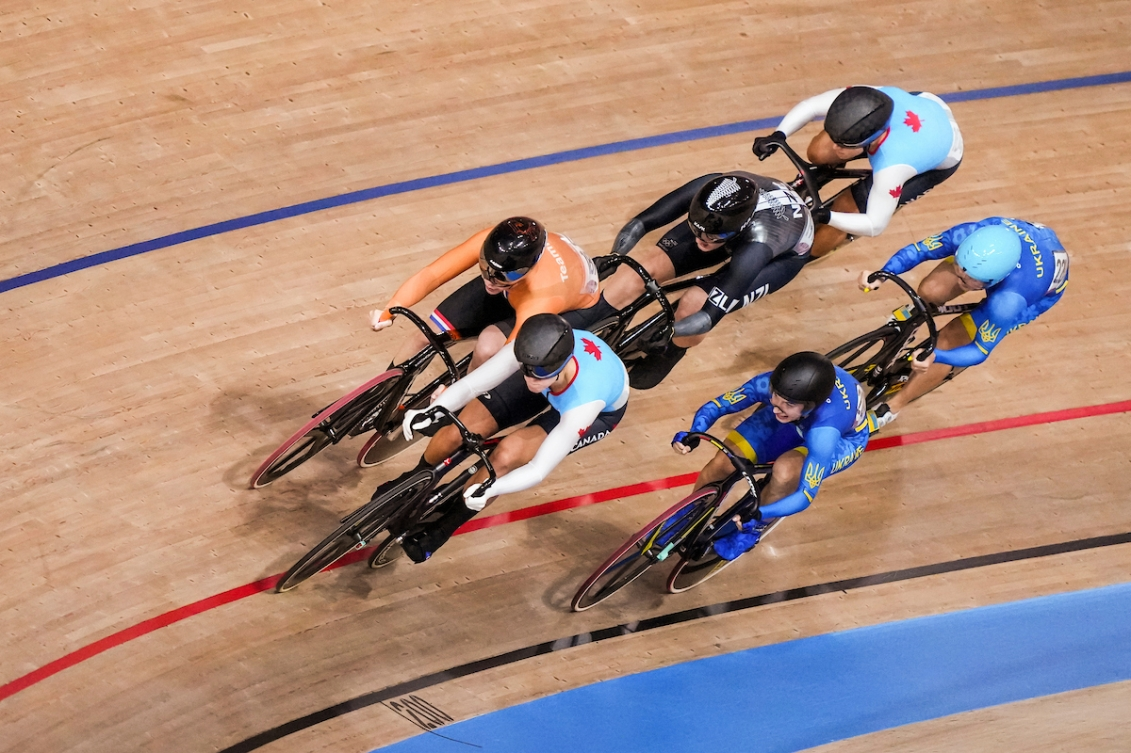 Kelsey Mitchell and Lauriane Genest race in the women's keirin final