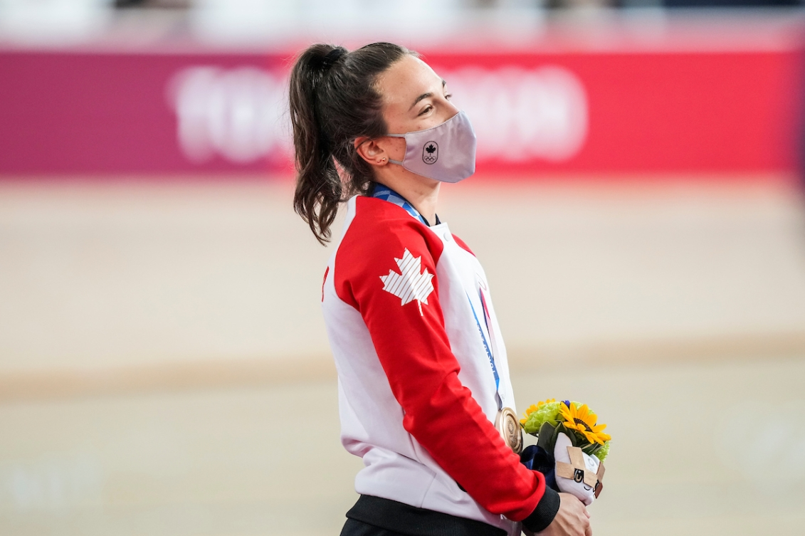 Canadian cyclist Lauriane Genest receiving her bronze medal