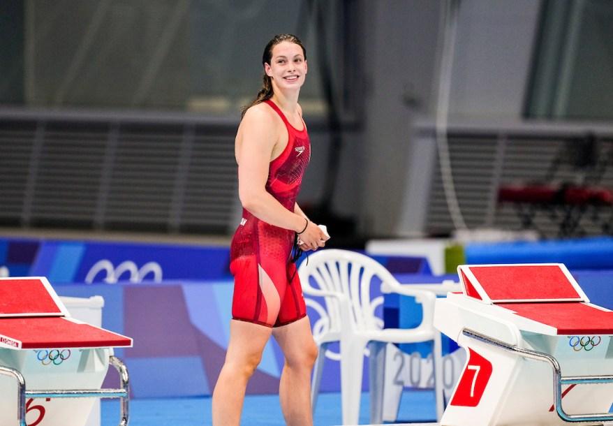 Penny Oleksiak standing on the pool deck