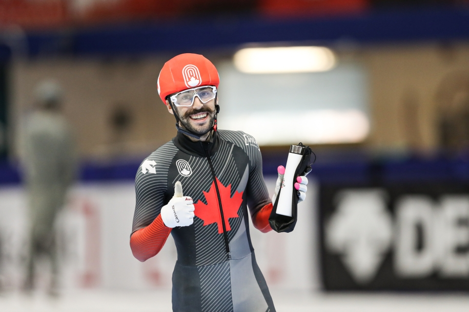 Steven Dubois gives a thumbs up while holding onto his water bottle.