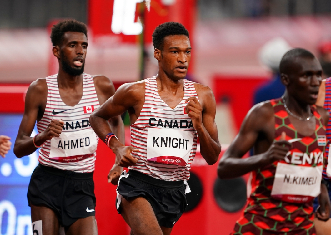 Justyn Knight in the 5000m race, with Mohammed Ahmed right behind him