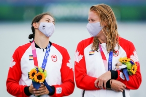 Laurence Vincent Lapointe and Katie Vincent smile at each other on the podium