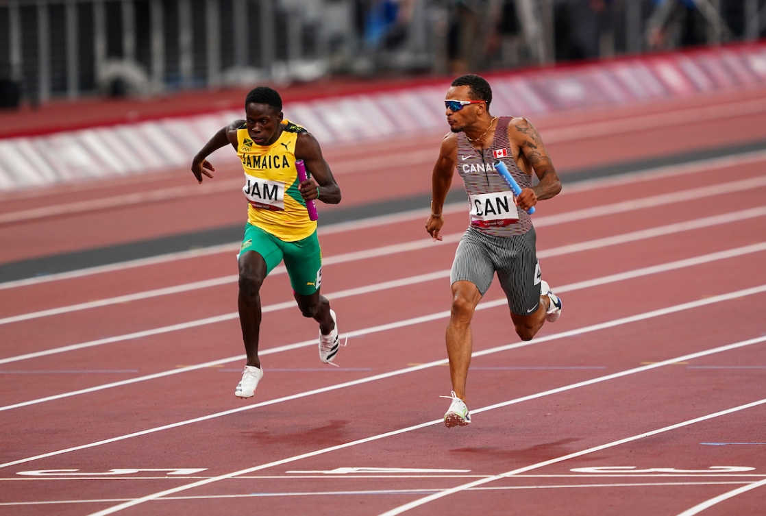 Andre De Grasse looks over the finish line in the men's 4x100 metre relay.