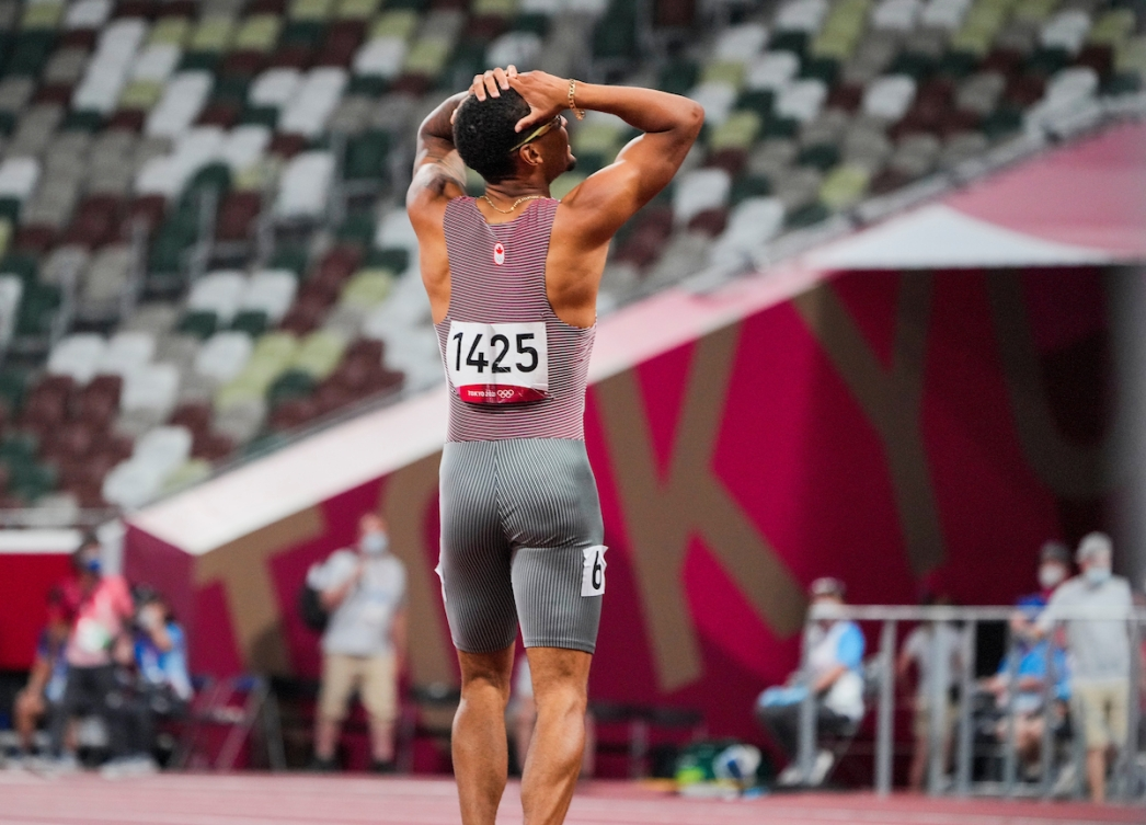 Andre De Grasse looks up at the scoreboard after 200-metre final