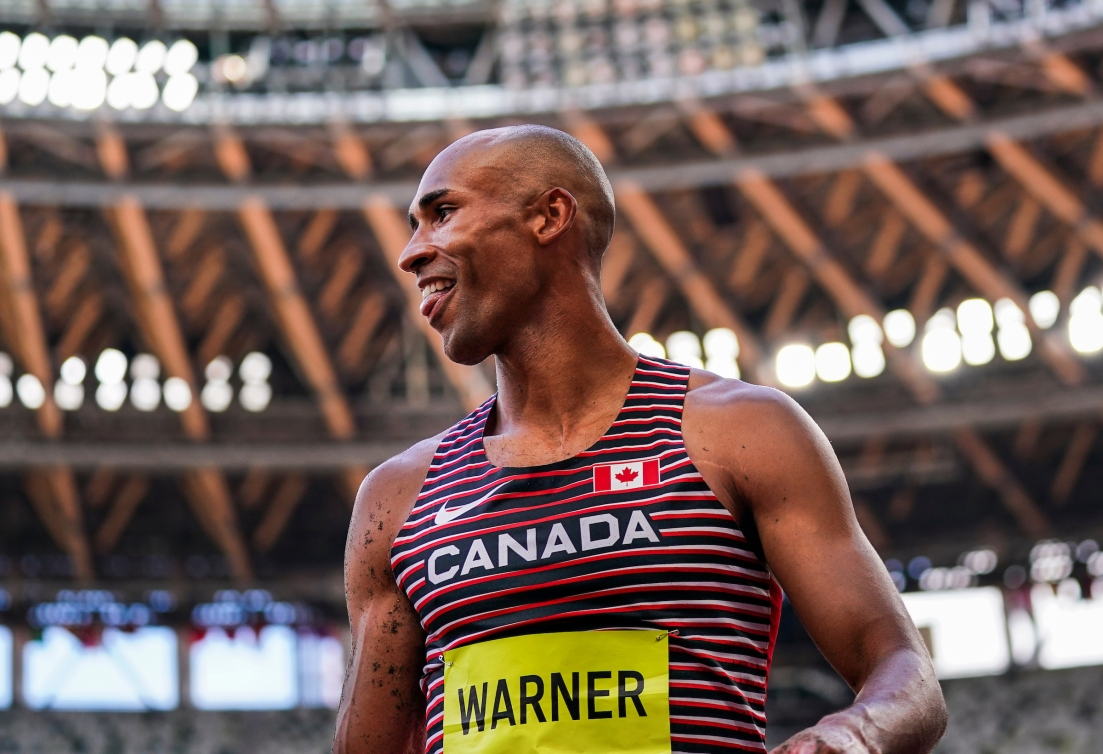 Damian Warner smiles while competing in the decathlon