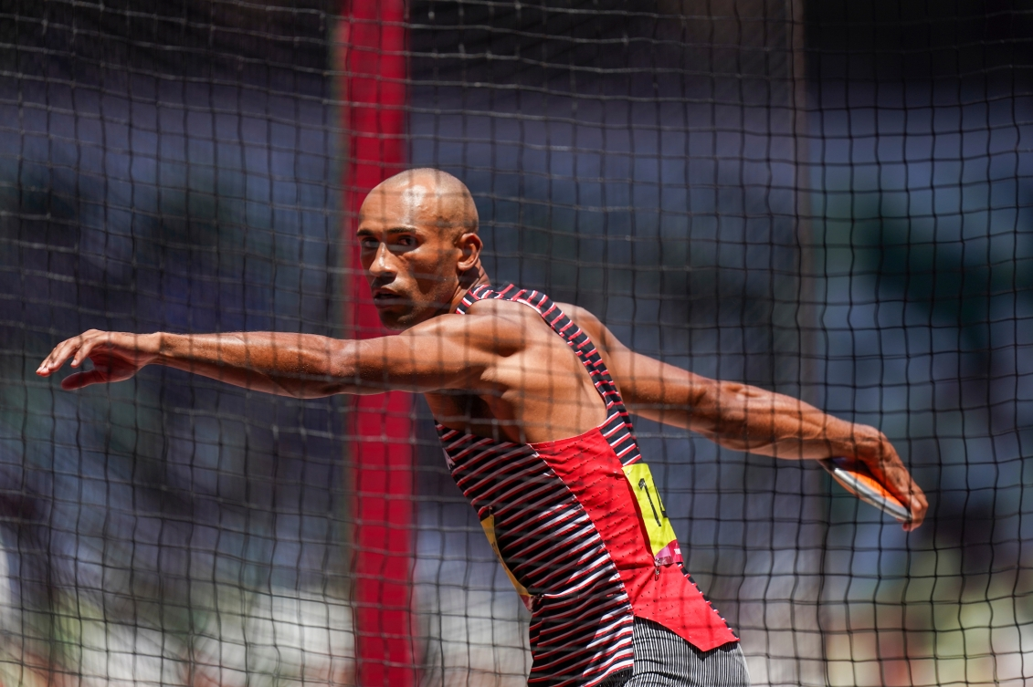 Damian Warner spins to throw the discus