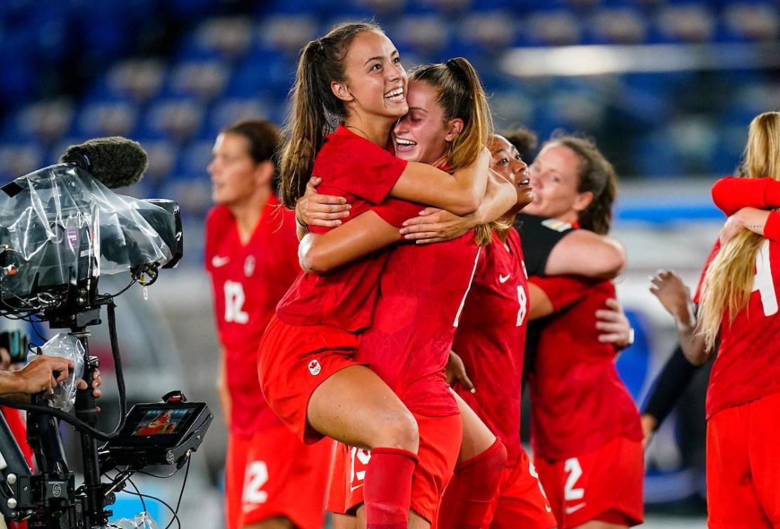 Team Canada Julia Grosso celebrates with teammate Jordyn Huitema