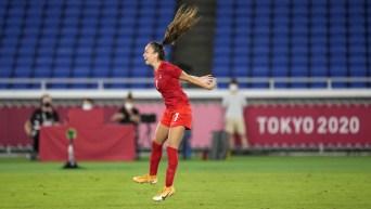 Julia Grosso jumps in celebration after scoring her gold medal winning goal in soccer