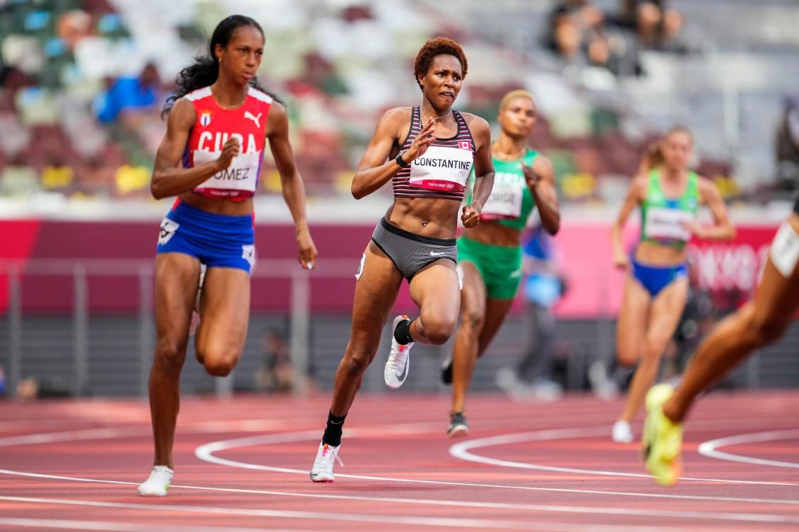 Kyra Constantine running on a track