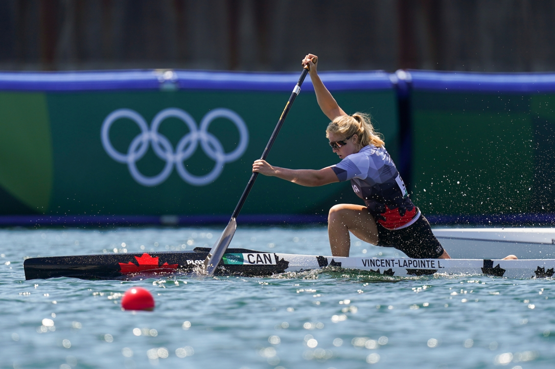 Laurence Vincent Lapointe paddles in a canoe