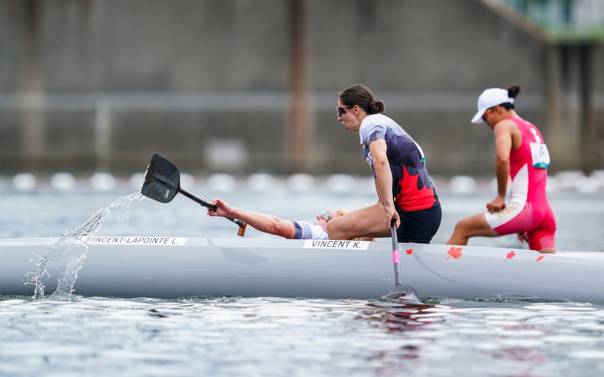 Laurence Vincent Lapointe falls out of the canoe in celebration