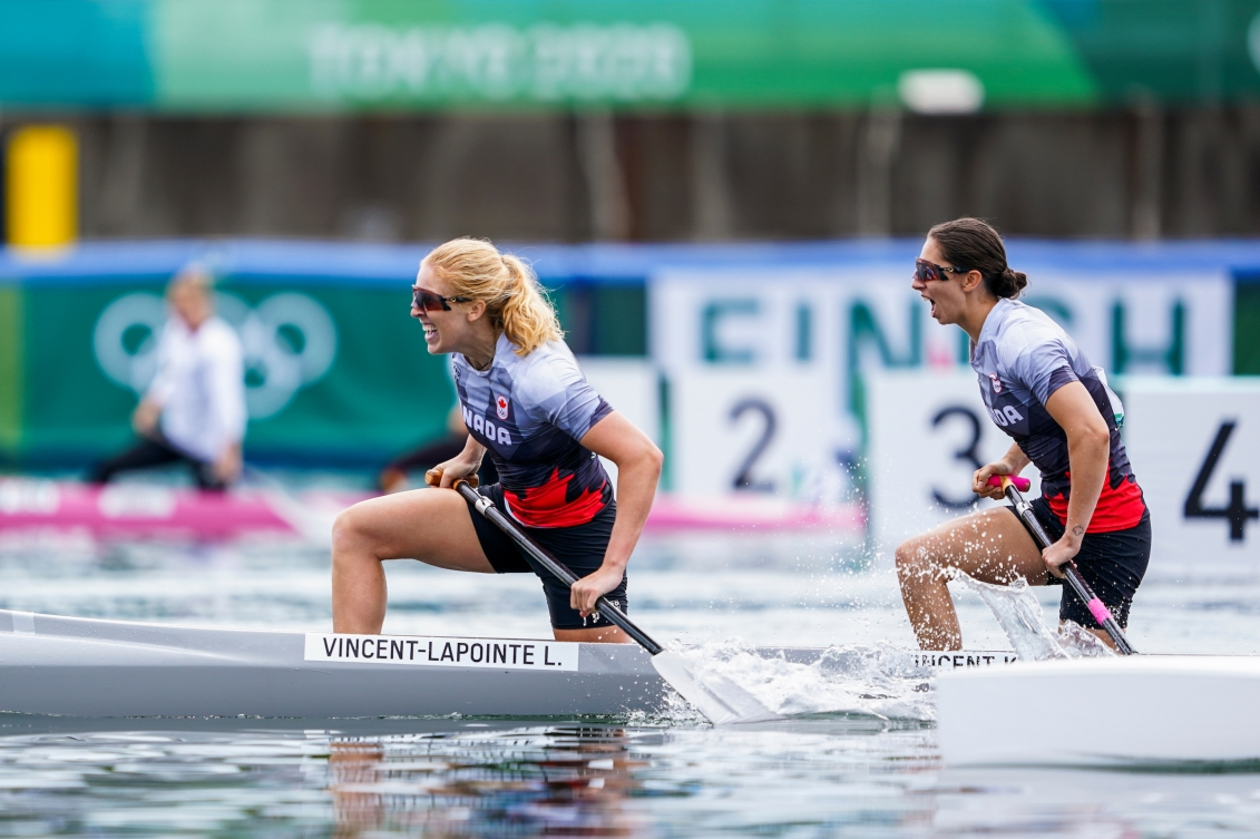 Laurence Vincent Lapointe and Katie Vincent smile in their canoe after winning bronze