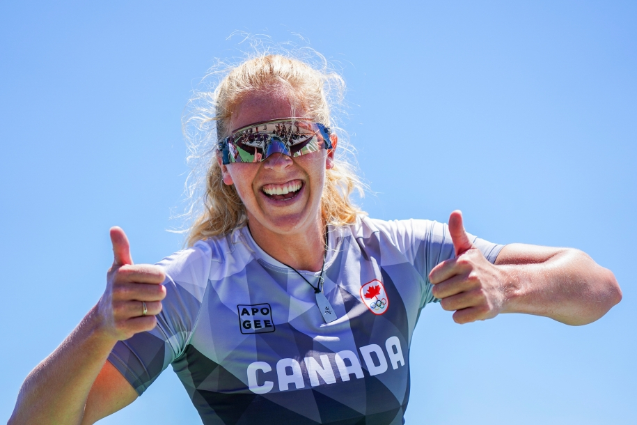 Laurence Vincent Lapointe gives two thumbs up after winning silver