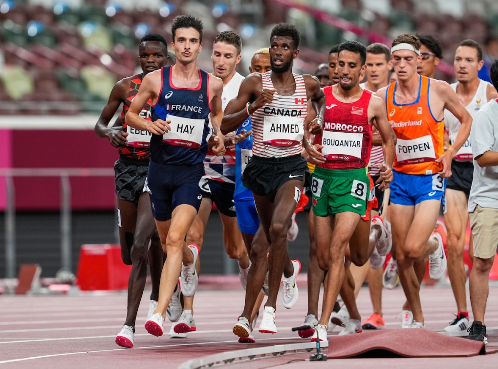 Mohammed Ahmed looks up at the board during the men's 5,000 metre qualification round.