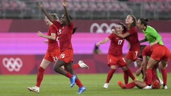 Team Canada soccer players celebrate their win
