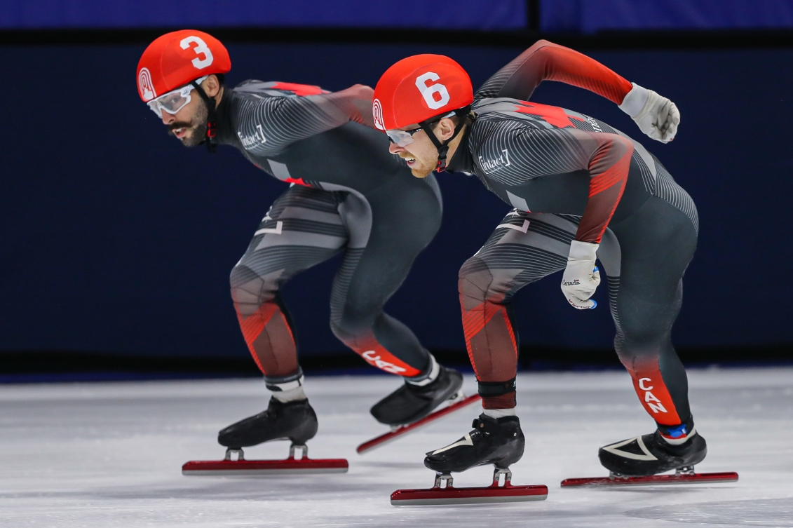 Two short track speed skaters racing
