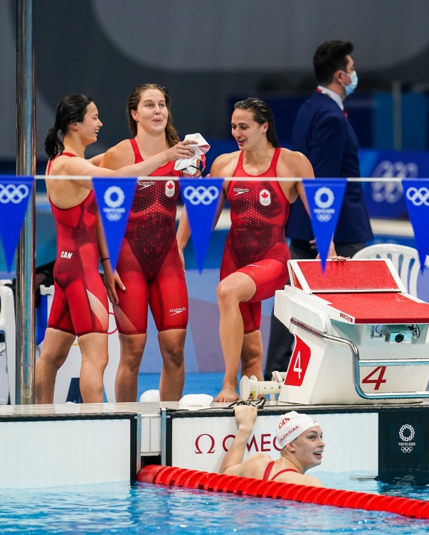 Canadian women's medley relay celebrates on pool deck