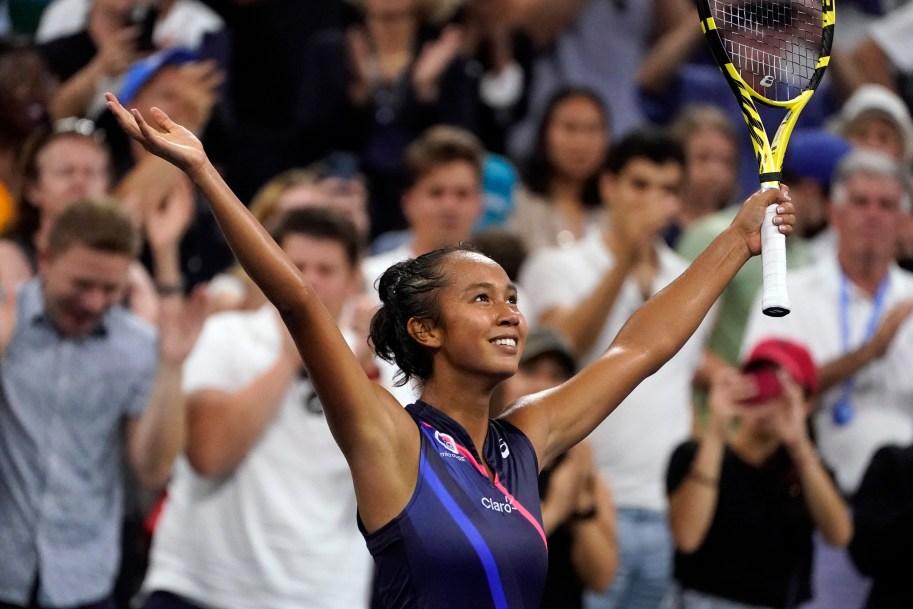 Leylah Fernandez raises her hands in the air in celebration.