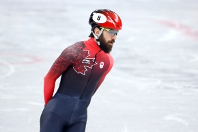 Charles Hamelin on the ice in his speed skating gear