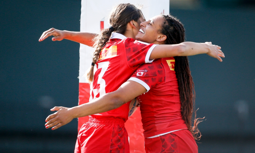 Canada's Kiri Ngawati celebrates with teammate Olivia De Couvreur on the rugby pitch