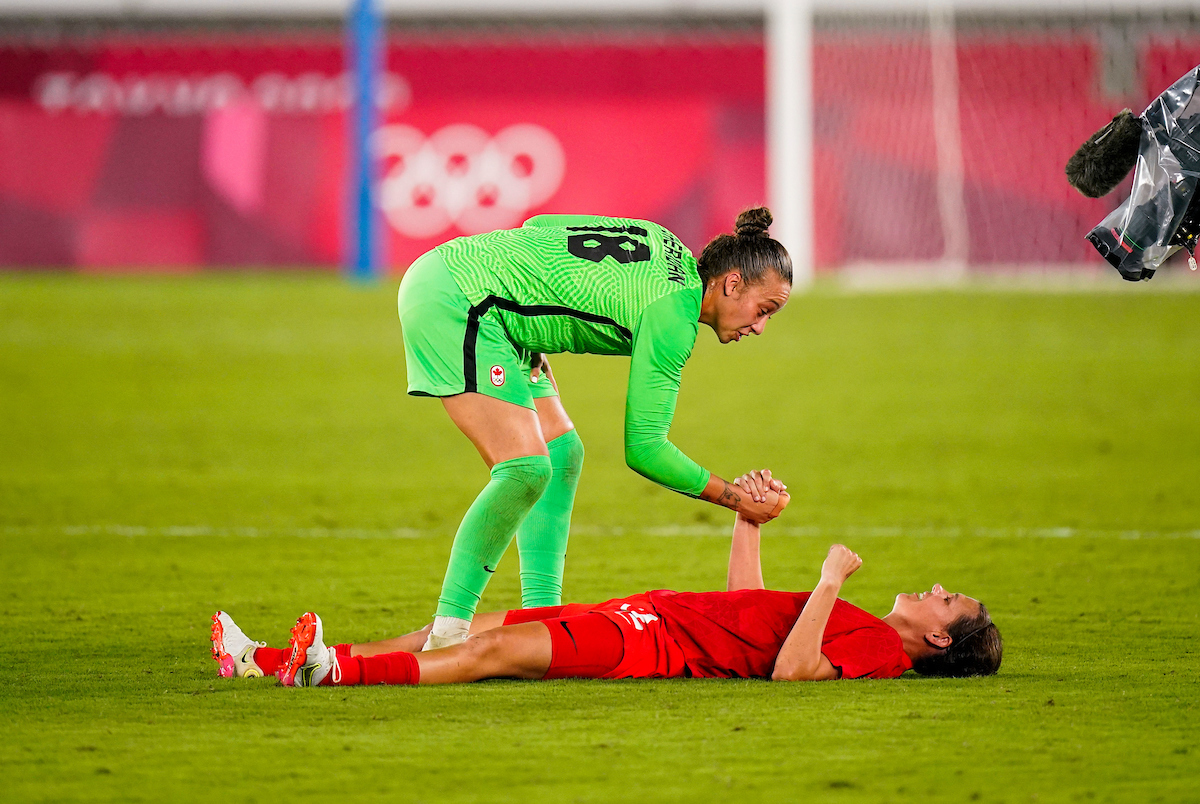 Christine Sinclair and Kailen Sheridan celebrate their win at Tokyo 2020