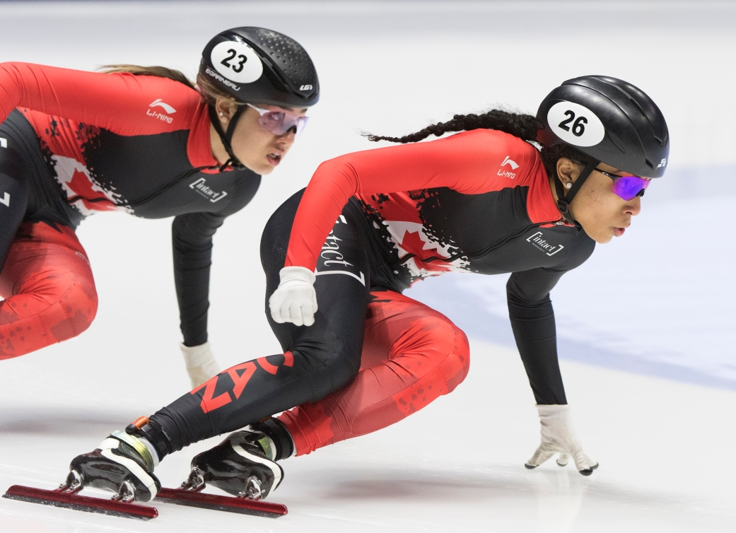 Alyson Charles and Courtney Sarault go around a turn in a short track race