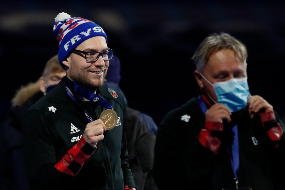 Laurent Dubreuil holds up his gold medal