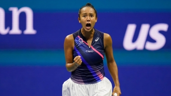Leylah Fernandez pumps her right fist and lets out a scream in celebration.