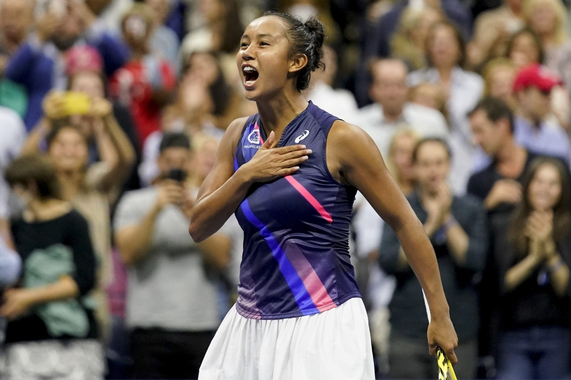 Leylah Fernandez taps her hand to her chest in celebration after a win