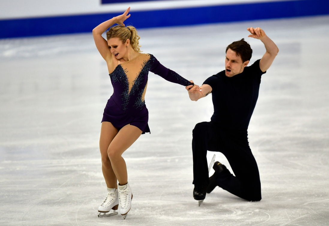 Kirsten Moore-Towers and Michael Marinaro hit the end pose of their figure skating program
