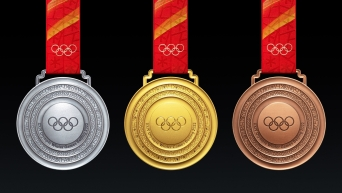 Gold silver and bronze Beijing 2022 medals showing the front view