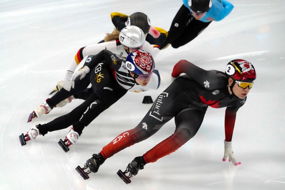 Choi Min-jeong of South Korea, left, and Courtney Sarault of Canada compete in a heat of the women's 1000m at the ISU World Cup Short Track speed skating competition, a test event for the 2022 Winter Olympics, at the Capital Indoor Stadium in Beijing, Friday, Oct. 22, 2021. (AP Photo/Mark Schiefelbein)