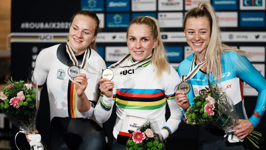 Kelsey Mitchell (right) on the podium with the two other women's sprint medallists
