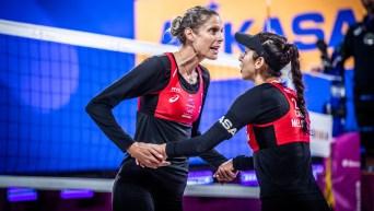 "Sarah Pavan (left) and Melissa Humana-Paredes ""low five"" during a match."