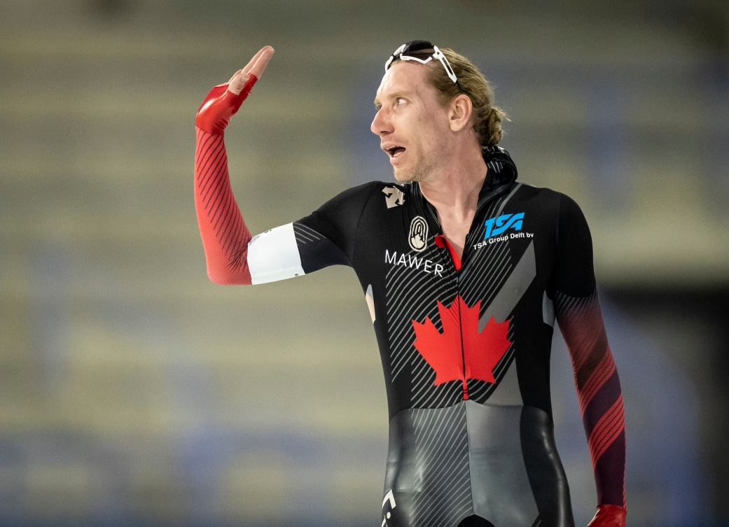 Ted-Jan Bloemen waves after winning a speed skating race
