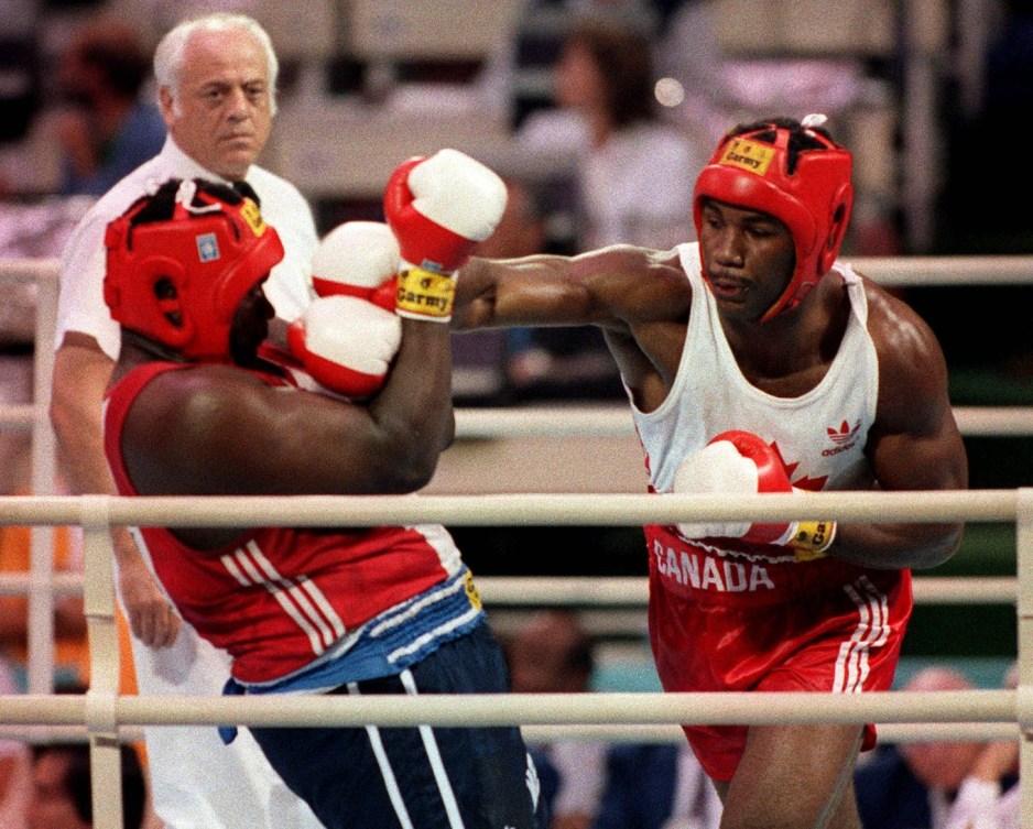 Lennox Lewis aux Jeux de Séoul frappe son adverse