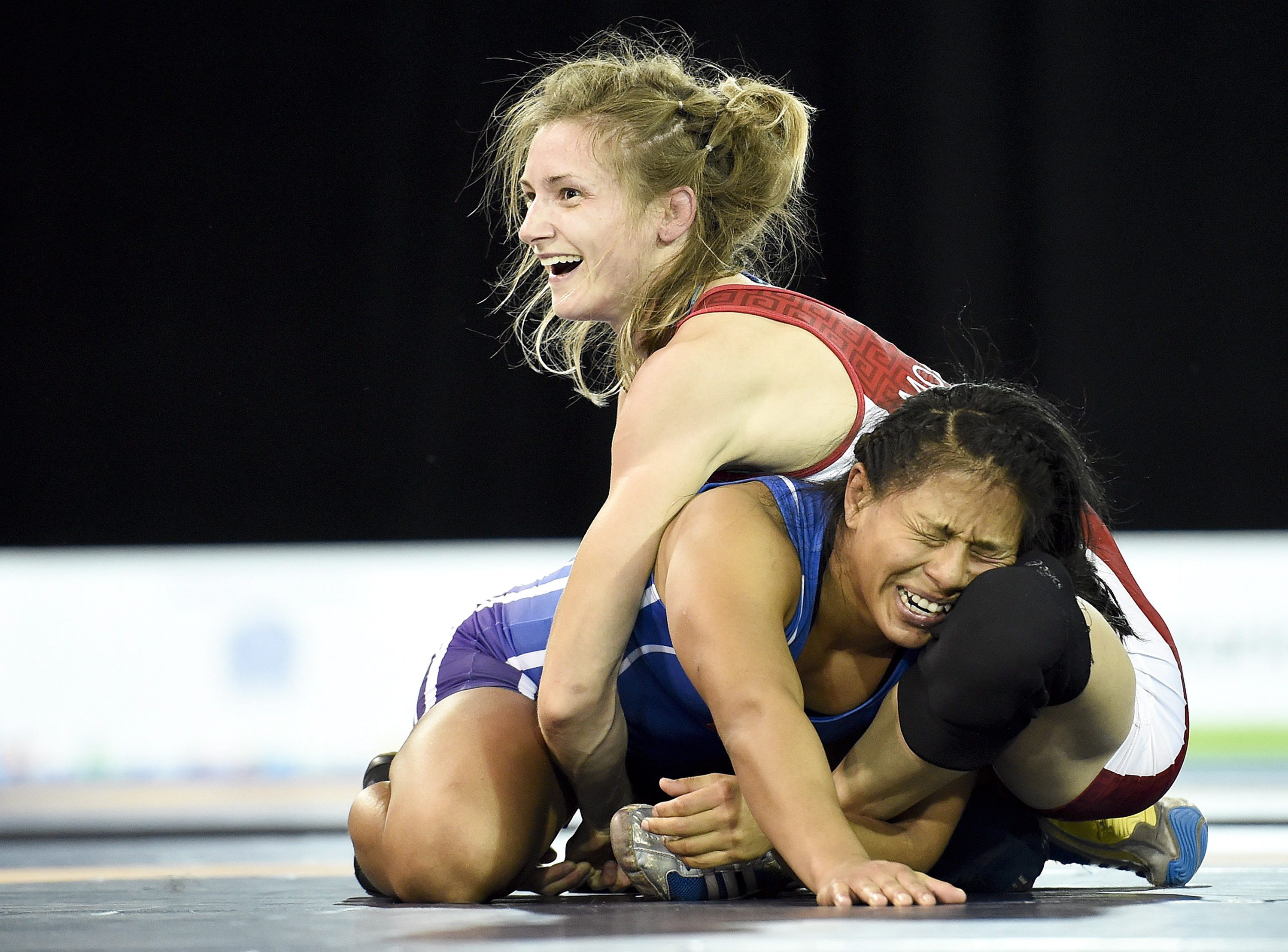 Gene Morrison, top, of Canada moments before time runs out to defeat Thalia Mallqui of Peru in the women's freestyle 48kg final during the Pan American Games in Toronto on Thursday, July 16, 2015. Morrison won gold. THE CANADIAN PRESS/Nathan Denette