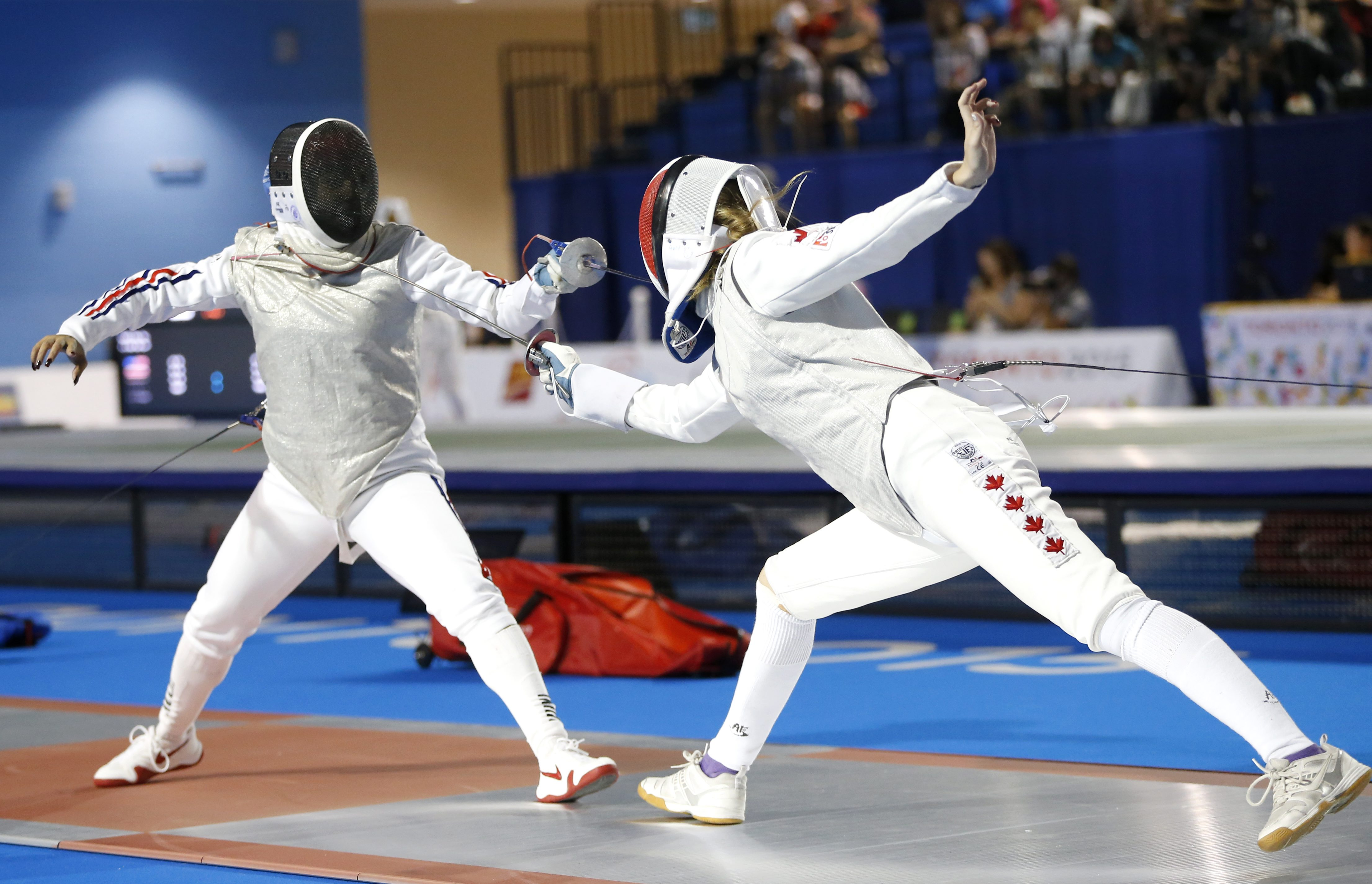 Cuba's Elizabeth Hidalgo, left, competes against Canada's Alanna Goldie during their women's foil individual quarterfinal match at the Pan Am Games, Wednesday, July 22, 2015, in Toronto. (AP Photo/Julio Cortez)