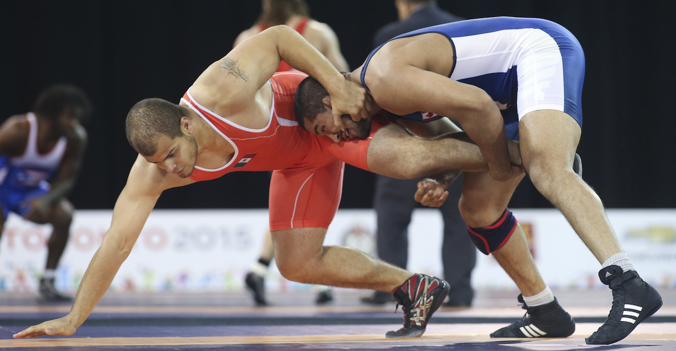 Arjun Gill (blue) of Surrey, B.C. defeated Jesse Ruiz of Mexico in the freestyle wrestling preliminaries at the PanAmerican Games in Mississauga, Ont., Saturday, July 18, 2015. Photo by Mike Ridewood/COC