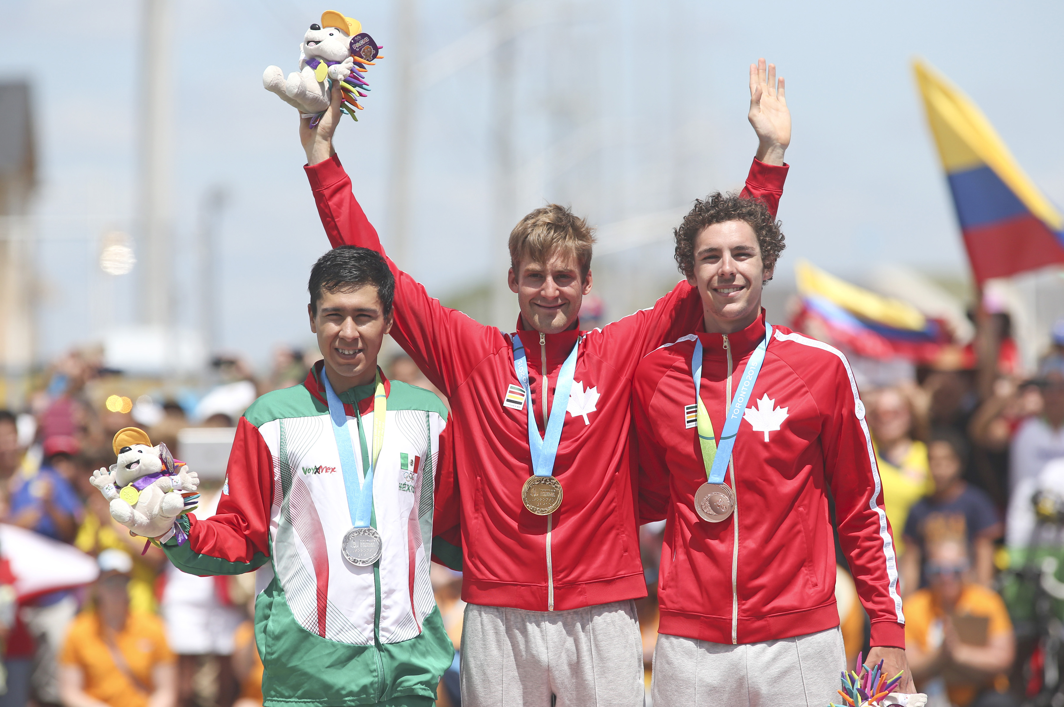 Medalist, from left Ignacio Prado of Mexico, silver, Hugo Houle of Ste-Perpetue, Que, gold and Sean MacKinnon of Hamilton, Ont.. bronze, in the cycling time trial at the Pan American Games in Milton, Ont., Tuesday, July 21, 2015. Photo by Mike Ridewood/COC