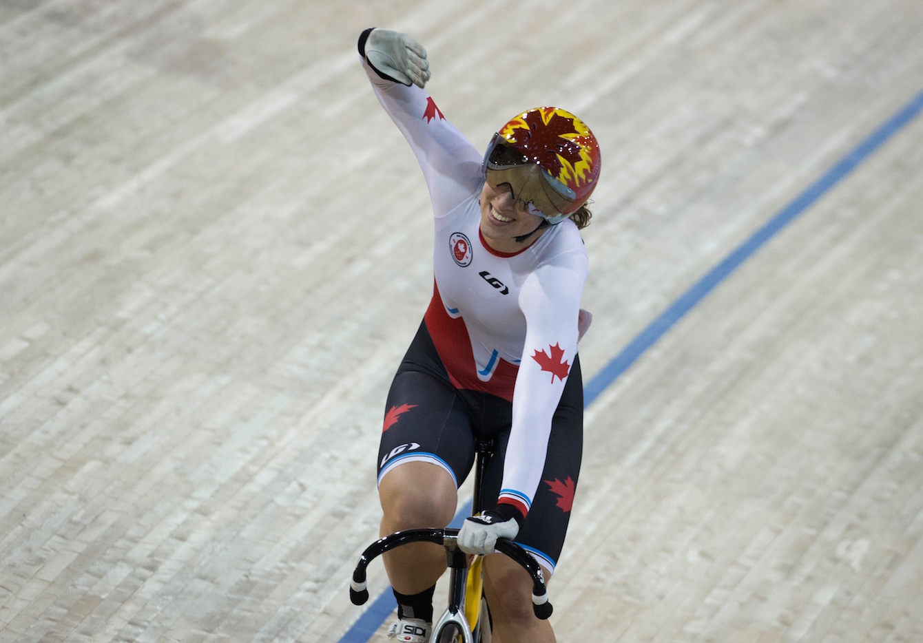 Monique Sullivan wins gold in the Women's Keirin at the Pan American Games in Toronto, July 17, 2015. COC Photo by Jason Ransom