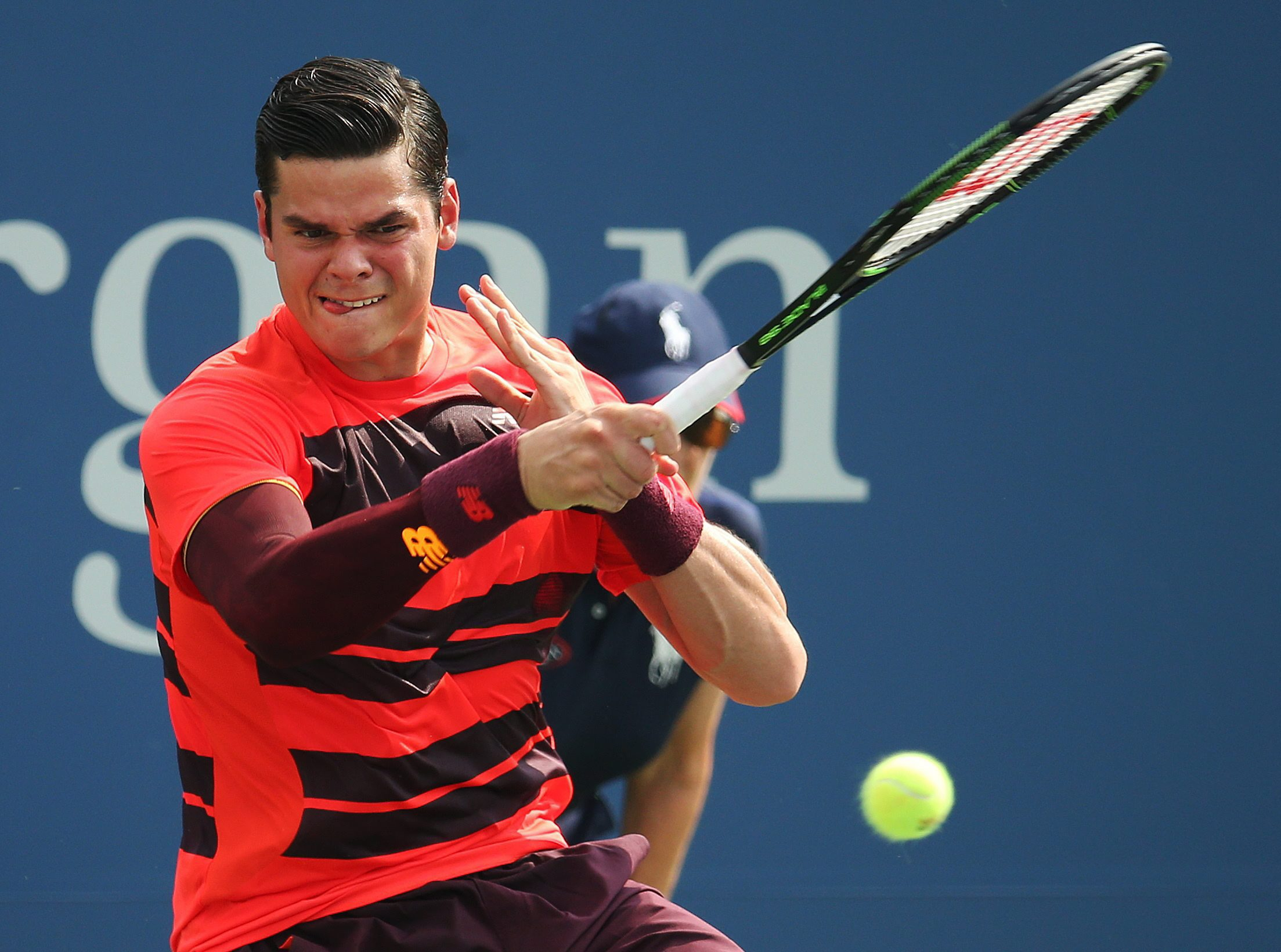 Milos Raonic, of Canada, returns a shot against Tim Smyczek, of the United States, during the first round of the U.S. Open tennis tournament, Monday, Aug. 31, 2015, in New York. (AP Photo/Adam Hunger)