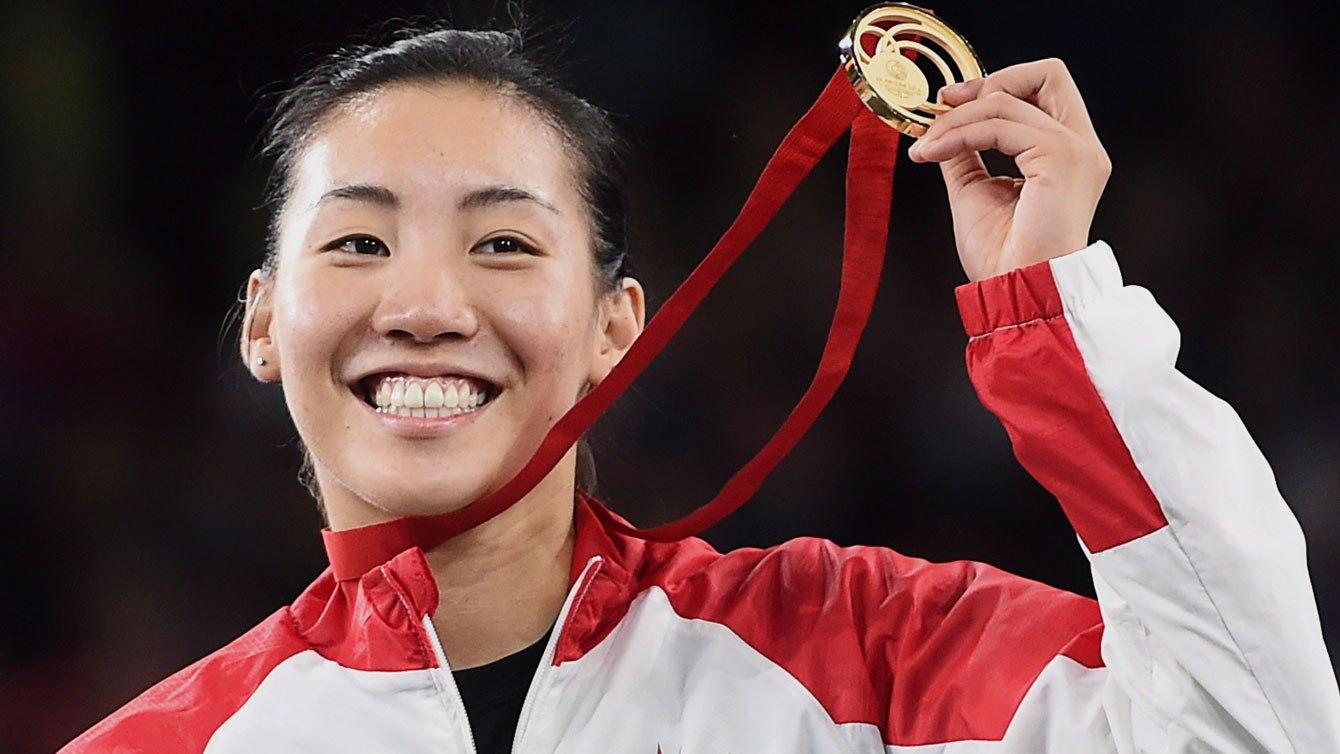 Michelle Li lors de la remise des médailles des Championnats du Commonwealth de 2014.