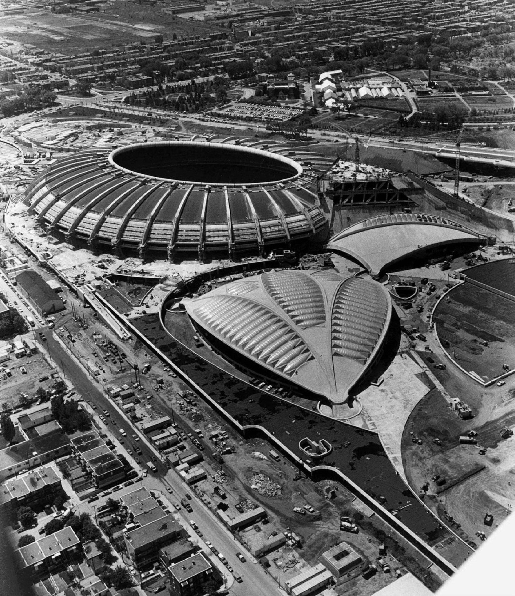 FILE - The Montreal Olympic Stadium and the Olympic Veledrome are shown in this June 1976 photo. It was 30 years ago that the 21st Olympic Games in Montreal opened. They were a huge success despite shocking cost over-runs and construction delays and the fact that there was no gold among the host country's 11 medals. (CP PICTURE ARCHIVE/stf)